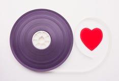 Bobine de film et couleurs rouges de vintage de coeur Photographie stock libre de droits