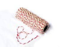 Bobine de la ficelle du boulanger rouge et blanc Photo stock