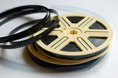 Bobine di pellicola su priorità bassa bianca Fotografie Stock