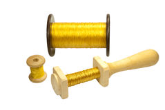 Bobines avec des amorçages d'or Images stock