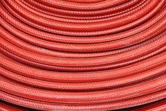 Bobinier de tuyau d'incendie rouge Photographie stock libre de droits