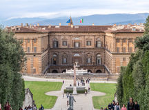 Boboli garden in Florence Italy. Florence, Italy - Oct 9, 2016 - View of Boboli Garden with the back facade of Palazzo Pitti and people who were visiting Royalty Free Stock Image