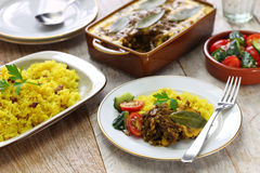 Bobotie and yellow rice, south african cuisine. Stock Photography