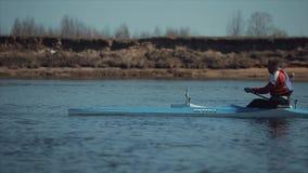 Bobruisk, Belarus - 11 May 2019: Man rowing in a canoe. Rowing, canoeing, paddling. Training. Kayaking. Tracking Shot. Bobruisk, Belarus - 11 May 2019: Man stock footage