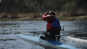 Bobruisk, Belarus - 11 May 2019: Rear view of Man rowing in a canoe. Rowing, canoeing, paddling. Training. Kayaking. Bobruisk, Belarus - 11 May 2019: Man rowing stock video