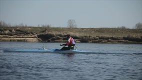 Bobruisk, Belarus - 11 May 2019: Man rowing in a canoe. Rowing, canoeing, paddling. Training. Kayaking. Tracking Shot. Bobruisk, Belarus - 11 May 2019: Man stock video footage