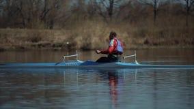 Bobruisk, Belarus - 11 May 2019: Sportsman in a canoe. Rowing, canoeing, paddling. Training. Kayaking. Tracking Shot. Bobruisk, Belarus - 11 May 2019: Sportsman stock video footage