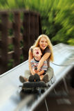 On the bobsled run. Boy with mother on the bobsled run Stock Images