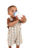 Boby Boy Drinking Milk with Bottle Stock Image