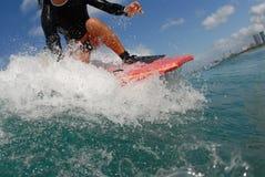 Bobyboarder girl. A bodyboarder teen girl doing a drop knee stock photo