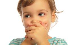 Boca cerrada de la muchacha de Llittle por las manos Fotos de archivo libres de regalías