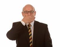 Boca da coberta do homem de negócios Foto de Stock Royalty Free
