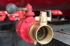 Boca de incêndio de fogo vermelho em um carro de bombeiros Fotografia de Stock Royalty Free