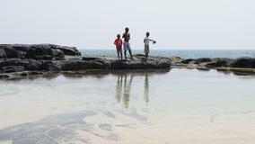 Boca de Inferno, Sao Tome and Principe. JANUARY 29, 2017: Fishing Kids on Boca de Inferno on January 29, 2017 in Sao Tome and Principe, Africa Royalty Free Stock Image