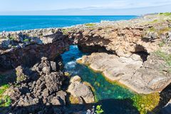 Boca do Inferno in Cascais, Portugal. View of a hole in a rock called the mouth of hell or Boca do Inferno in Cascais in Portugal royalty free stock image