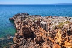 Boca do Inferno chasm and seaside cliffs. Boca do Inferno. Hell`s Mouth chasm and seaside cliffs. Natural landmark of Cascais city, District of Lisbon, Portugal Stock Photography