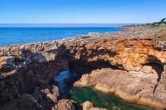 Boca do Inferno. Hell`s Mouth chasm, Cascais. Boca do Inferno. Hell`s Mouth chasm located in seaside cliffs. Natural landmark of Cascais city, District of Lisbon Royalty Free Stock Image
