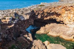 Boca do Inferno. Hell`s Mouth chasm, Portugal. Boca do Inferno. Hell`s Mouth chasm located in seaside cliffs. Natural landmark of Cascais city in the District of Royalty Free Stock Photos