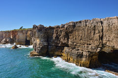 Boca do inferno, Portugal. Boca do inferno - stone arches and grotto, the natural wonder on the Atlantic ocean coast nearby Cascais, Lisbon, Portugal Stock Photo