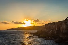 Boca do Inferno sunset. A sunset in boca do inferno portugal with the sea Royalty Free Stock Photo