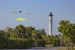 Boca Grande lighthouse. On Gasparilla Island in Florida with blue sky and colorful kites Stock Images