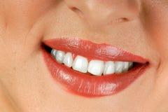 Boca sonriente de la mujer Foto de archivo