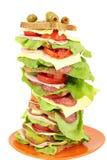 Bocadillo alto con la ensalada y el queso del jamón en blanco Fotografía de archivo