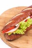 Bocadillo con lechuga del queso del jamón en el tablero de madera con el espacio de la copia Imagen de archivo libre de regalías