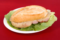 Bocadillo con lomo. Warm spanish bread with pork and cheese Stock Images