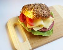 Bocadillo con queso y el tomate Fotos de archivo