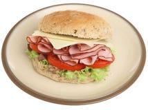 Bocadillo del rollo del jamón, del queso y de la ensalada aislado Foto de archivo libre de regalías