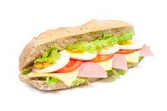 Bocadillo del tomate, del salami y del queso Imagen de archivo libre de regalías