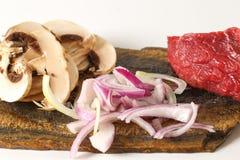 Bocadillo sabroso de la seta de la cebolla del filete de carne de vaca en un ciabatta Foto de archivo libre de regalías