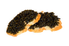 Bocadillos aislados con el caviar negro Fotografía de archivo libre de regalías