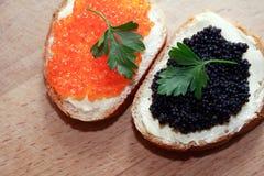 Bocadillos con el caviar Foto de archivo libre de regalías