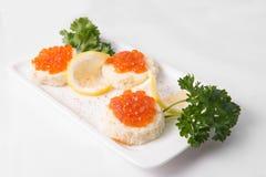 Bocadillos con el caviar rojo Fotografía de archivo