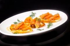 Bocadillos con los salmones salados Fotos de archivo libres de regalías