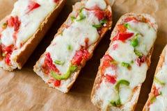 Bocadillos de la pizza del Baguette Imagenes de archivo