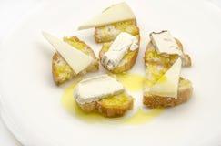 Bocado del queso del pan y de cabra Fotografía de archivo libre de regalías