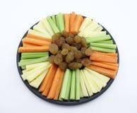Bocado sano de la fruta y verdura. Fotos de archivo