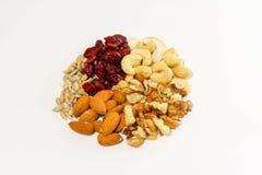 Bocados, anacardos, walnutrs, semillas de girasol y arándanos sanos foto de archivo