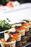 Bocados con las huevas de color salmón Foto de archivo