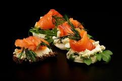 Bocados de color salmón fumados Foto de archivo libre de regalías