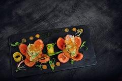 Bocados de los mariscos con los tomates Imagen de archivo libre de regalías