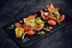 Bocados de los mariscos con los tomates Foto de archivo