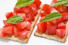 Bocados del tomate Imagen de archivo libre de regalías
