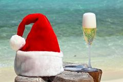 Bocal of champagne is on a beach Royalty Free Stock Photos