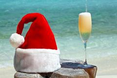 Bocal of champagne is on a beach Stock Photos