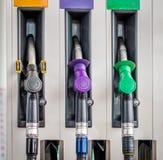 Bocas cifradas color del surtidor de gasolina imágenes de archivo libres de regalías