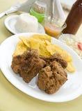 Bocas e tostones del pollo Immagini Stock Libere da Diritti